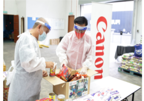 Canon and Employees Provide Food Aid to Families